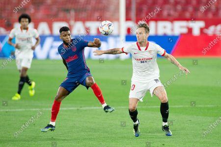 Thomar Lemar of Atletico and Ivan Rakitic of Sevilla