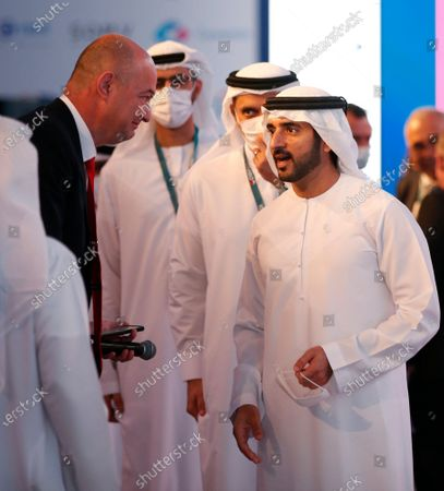 His Highness Sheikh Hamdan bin Mohammed bin Rashid Al Maktoum(R) , Crown Prince of Dubai and Chairman of Dubai Executive Council speaks to Yigal Unna Director General, Israel National Cyber Directorate, Israel during the Cybertech Global in the Gulf emirate of Dubai, United Arab Emirates, 05 April 2021. The 8th edition of Cybertech Global international exhibition and conference is taking place for the first time in Dubai and runs until 07 April 2021.