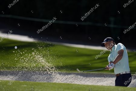 Matt Jones hits from the bunker on the fourth hole during a practice round for the Masters golf tournament, in Augusta, Ga