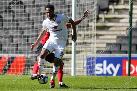Stock Photo of Milton Keynes Dons forward Cameron Jerome (35) controls the ball during the EFL Sky Bet League 1 match between Milton Keynes Dons and Crewe Alexandra at stadium mk, Milton Keynes