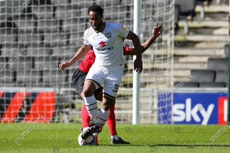 Milton Keynes Dons forward Cameron Jerome (35) is tackled during the EFL Sky Bet League 1 match between Milton Keynes Dons and Crewe Alexandra at stadium mk, Milton Keynes
