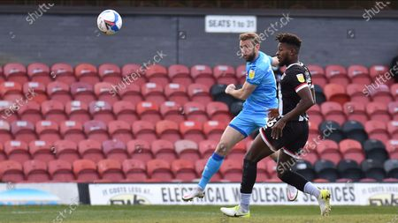 Cheltenham Town's Andy Williams shoots during the EFL Sky Bet League 2 match between Grimsby Town FC and Cheltenham Town at Blundell Park, Grimsby