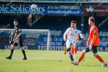 Stock Image of Barnsley Midfielder Alex Mowatt (27) crosses the ball as Luton Town Midfielder George Moncur (14) tries to intercept during the EFL Sky Bet Championship match between Luton Town and Barnsley at Kenilworth Road, Luton
