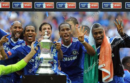 Nicolas Anelka, Florent Malouda, Juliano Belletti, Didier Drogab and Salomon Kalou of Chelsea celebrate with the FA Cup