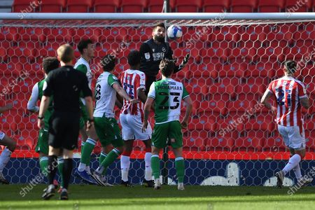 Stock Picture of Millwall goalkeeper Bartosz Bialkowski(33)  makes a save during the EFL Sky Bet Championship match between Stoke City and Millwall at the Bet365 Stadium, Stoke-on-Trent