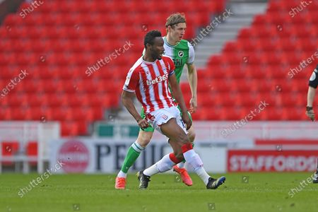 Stoke City midfielder Mikel John Obi (13) plays a pass during the EFL Sky Bet Championship match between Stoke City and Millwall at the Bet365 Stadium, Stoke-on-Trent