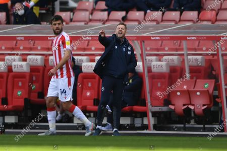 Millwall Manager Gary Rowett pointing, directing, signalling, gesture in the technical area during the EFL Sky Bet Championship match between Stoke City and Millwall at the Bet365 Stadium, Stoke-on-Trent
