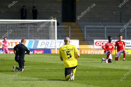 Michael Bostwick of Burton Albion (5) takes a knee during the EFL Sky Bet League 1 match between Burton Albion and Swindon Town at the Pirelli Stadium, Burton upon Trent