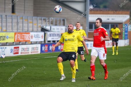 Michael Bostwick of Burton Albion (5) and Brett Pitman of Swindon Town (8) battle for the ball during the EFL Sky Bet League 1 match between Burton Albion and Swindon Town at the Pirelli Stadium, Burton upon Trent
