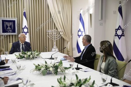 Hili Tropper and Orit Farkash-Hacohen, politicians from the Blue and White party, headed by Benny Gantz, attend a consultation with Israeli President Reuven Rivlin on who might form the next coalition government, at the President's residence in Jerusalem on Monday, April 5, 2021.