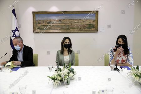 Hili Tropper, Orit Farkash-Hacohen and Yael Ron Ben-Moshe, politicians from the Blue and White party, headed by Benny Gantz, attend a consultation with Israeli President Reuven Rivlin on who might form the next coalition government, at the President's residence in Jerusalem on Monday, April 5, 2021.