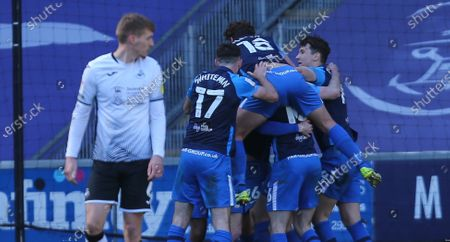 Preston players celebrate with Scott Sinclair after he scores goal