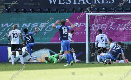 Scott Sinclair of Preston North End beats Swansea City goalkeeper Freddie Woodman to score goal