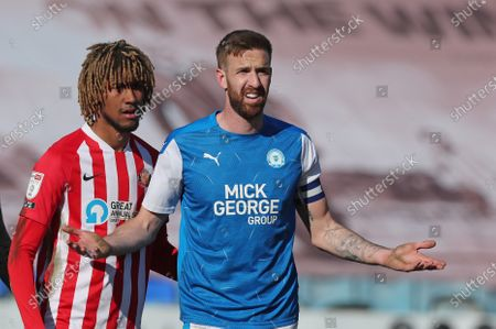 Stock Photo of Peterborough United's Mark Beevers and Sunderland's Dion Sanderson during Peterborough United vs Sunderland AFC, Sky Bet EFL League 1 Football at London Road on 5th April 2021