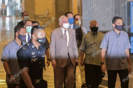 Malaysia's former prime minister Najib Razak (C) arrives at the Court of Appeal in Putrajaya, Malaysia on April 5, 2021. Malaysia's Court of Appeal on April 5, will begin hearing a bid by Najib to set aside his conviction on corruption charges in a case linked to a multibillion-dollar scandal at state fund 1Malaysia Development Berhad (1MDB).