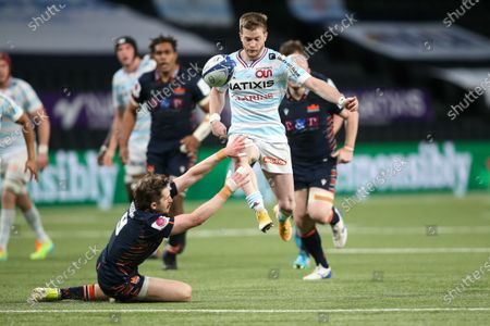 Racing 92's French left wing Louis Dupichot (top) kicks the ball to escape from addressed from Edinburgh's Scottish scrum-half Henry Pyrgos (bottom)