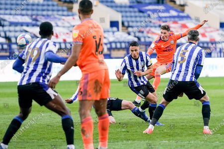 Cardiff City midfielder Harry Wilson (23) takes a shot during the EFL Sky Bet Championship match between Sheffield Wednesday and Cardiff City at Hillsborough, Sheffield