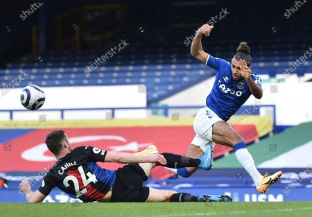 Crystal Palace's Gary Cahill, left, and Everton's Dominic Calvert-Lewin challenge for the ball during the English Premier League soccer match between Everton and Crystal Palace at Goodison Park in Liverpool, England
