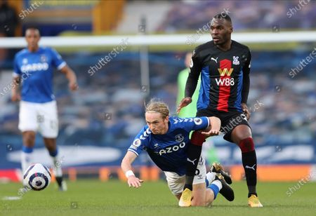 Everton's Tom Davies, left, and Crystal Palace's Christian Benteke challenge for the ball during the English Premier League soccer match between Everton and Crystal Palace at Goodison Park in Liverpool, England