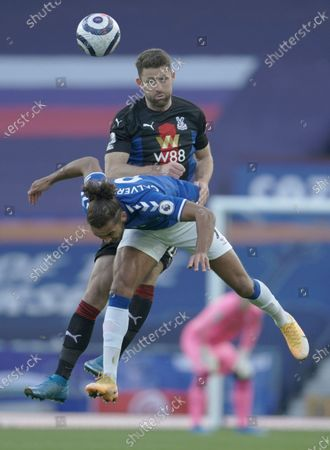 Crystal Palace's Gary Cahill, top and Everton's Dominic Calvert-Lewin challenge for the ball during the English Premier League soccer match between Everton and Crystal Palace at Goodison Park in Liverpool, England