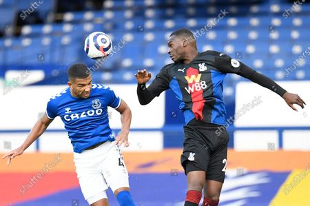 Everton's Mason Holgate, left, and Crystal Palace's Christian Benteke challenge for the ball during the English Premier League soccer match between Everton and Crystal Palace at Goodison Park in Liverpool, England