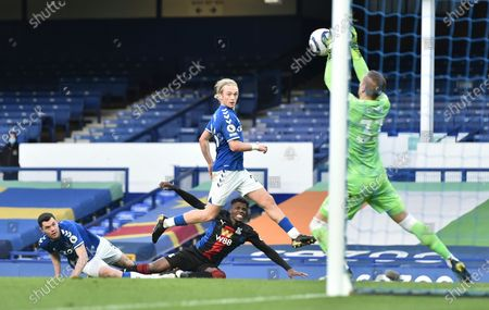 Crystal Palace's Wilfried Zaha has a shot at goal saved by Everton's Robin Olsen during the English Premier League soccer match between Everton and Crystal Palace at Goodison Park in Liverpool, England