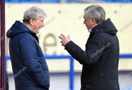 Crystal Palace's manager Roy Hodgson, left, and Everton's manager Carlo Ancelotti talk before the English Premier League soccer match between Everton and Crystal Palace at Goodison Park in Liverpool, England