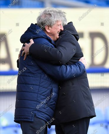 Crystal Palace's manager Roy Hodgson, left, and Everton's manager Carlo Ancelotti hug each other before the English Premier League soccer match between Everton and Crystal Palace at Goodison Park in Liverpool, England