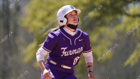 Stock Image of Furman's Natalie Morgan runs the bases during an NCAA college softball game against North Carolina Greenville, in Greenville, S.C. Furman won 4-1
