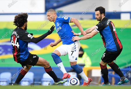 Everton's Richarlison (C) is tackled by Crystal Palace's Jairo Riedewald (L) and Crystal Palace's Luka Milivojevic (R) during the English Premier League soccer match between Everton FC and Crystal Palace in Liverpool, Britain, 05 April 2021.
