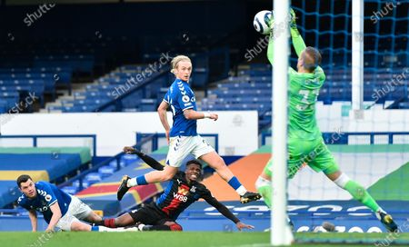Everton's goalkeeper Robin Olsen (R) saves a shot from Crystal Palace's Wilfried Zaha (down, center) during the English Premier League soccer match between Everton FC and Crystal Palace in Liverpool, Britain, 05 April 2021.
