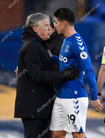 Everton's James Rodriguez (R) is embraced by Everton's manager Carlo Ancelotti (L) after being replaced during the English Premier League soccer match between Everton FC and Crystal Palace in Liverpool, Britain, 05 April 2021.