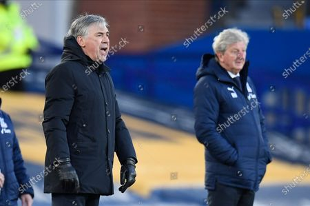 Everton's manager Carlo Ancelotti (L) reacts during the English Premier League soccer match between Everton FC and Crystal Palace in Liverpool, Britain, 05 April 2021.