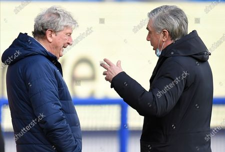 Crystal Palace's manager Roy Hodgson (L) and Everton's manager Carlo Ancelotti (R) chat before the English Premier League soccer match between Everton FC and Crystal Palace in Liverpool, Britain, 05 April 2021.