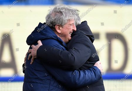 Crystal Palace's manager Roy Hodgson (L) and Everton's manager Carlo Ancelotti (R) embrace each other before the English Premier League soccer match between Everton FC and Crystal Palace in Liverpool, Britain, 05 April 2021.
