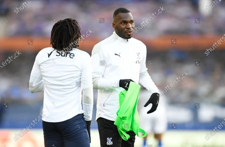 Crystal Palace's Christian Benteke (R) warms up before the English Premier League soccer match between Everton FC and Crystal Palace in Liverpool, Britain, 05 April 2021.
