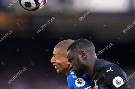 Everton's Richarlison (L) and Crystal Palace's Cheikhou Kouyate (R) fight for a high ball during the English Premier League soccer match between Everton FC and Crystal Palace in Liverpool, Britain, 05 April 2021.