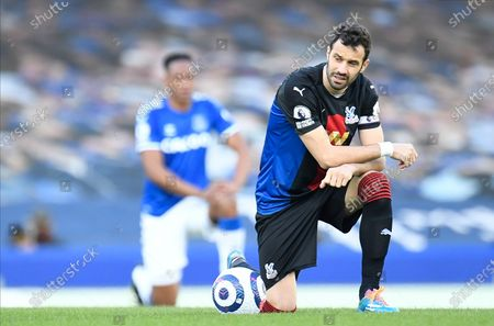 Crystal Palace's Luka Milivojevic takes a knee  for the Black Lives Matter cause before the English Premier League soccer match between Everton FC and Crystal Palace in Liverpool, Britain, 05 April 2021.