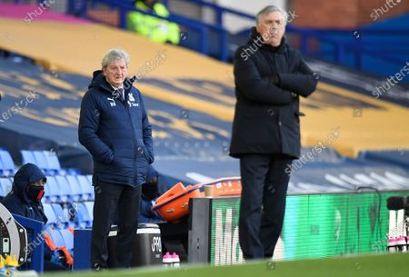 Crystal Palace's manager Roy Hodgson (L) and Everton's manager Carlo Ancelotti (R) look on during the English Premier League soccer match between Everton FC and Crystal Palace in Liverpool, Britain, 05 April 2021.