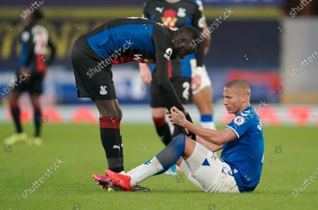 Crystal Palace's Cheikhou Kouyate (L) comforts Everton's Richarlison (down) after the English Premier League soccer match between Everton FC and Crystal Palace in Liverpool, Britain, 05 April 2021.