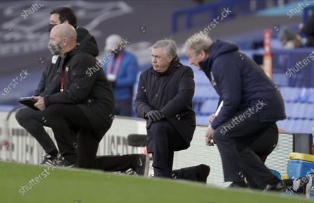 Everton's manager Carlo Ancelotti (C) takes a knee for the Black Lives Matter cause before the English Premier League soccer match between Everton FC and Crystal Palace in Liverpool, Britain, 05 April 2021.