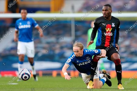 Everton's Tom Davies (down) and Crystal Palace's Christian Benteke (R) in action during the English Premier League soccer match between Everton FC and Crystal Palace in Liverpool, Britain, 05 April 2021.