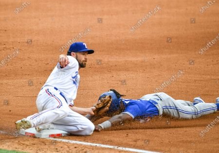 Texas Rangers shortstop Charlie Culberson #2 applies the tag to catch Toronto Blue Jays center fielder Jonathan Davis #3 attempting to steal third base in the top of the fourth inning during an Opening Day MLB game between the Toronto Blue Jays and the Texas Rangers at Globe Life Field in Arlington, TX Albert Pena/CSM