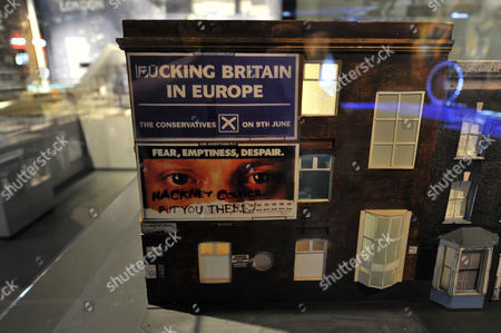 A model of a house displaying a Conservative Party poster created by artist Tom Hunter. Galleries of Modern London, England, Britain.