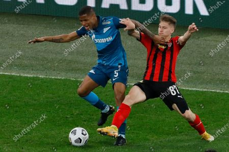 Stock Picture of Wilmar Barrios (L) of Zenit Saint Petersburg and Kirill Bozhenov of Khimki vie for the ball during the Russian Premier League match between FC Zenit Saint Petersburg and FC Khimki on April 5, 2021 at Gazprom Arena in Saint Petersburg, Russia.