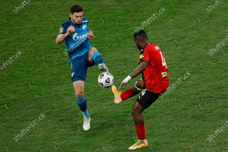 Magomed Ozdoev (L) of Zenit Saint Petersburg and Brian Idowu of Khimki vie for the ball during the Russian Premier League match between FC Zenit Saint Petersburg and FC Khimki on April 5, 2021 at Gazprom Arena in Saint Petersburg, Russia.