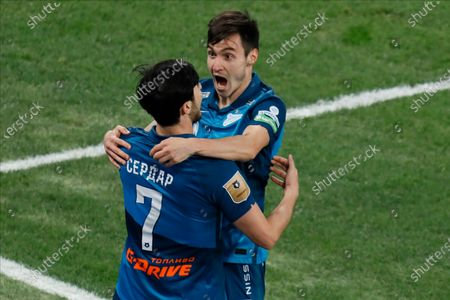 Vyacheslav Karavaev (R) and Sardar Azmoun of Zenit Saint Petersburg celebrate a goal during the Russian Premier League match between FC Zenit Saint Petersburg and FC Khimki on April 5, 2021 at Gazprom Arena in Saint Petersburg, Russia.