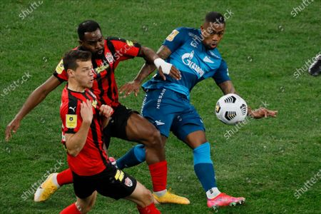 Stock Picture of Malcom (R) of Zenit Saint Petersburg shoots on goal as Yegor Danilkin (L) and Brian Idowu of Khimki during the Russian Premier League match between FC Zenit Saint Petersburg and FC Khimki on April 5, 2021 at Gazprom Arena in Saint Petersburg, Russia.