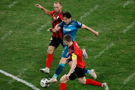 Sardar Azmoun (C) of Zenit Saint Petersburg vies for the ball with Denis Glushakov (L) and Dmitri Tikhiy of Khimki during the Russian Premier League match between FC Zenit Saint Petersburg and FC Khimki on April 5, 2021 at Gazprom Arena in Saint Petersburg, Russia.