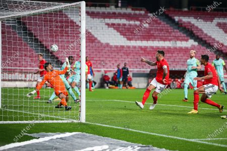 Benfica's Nicolas Otamendi (C) misses a goal opportunity during the Portuguese First League Soccer match between SL Benfica and Maritimo Funchal  held at Luz Stadium, in Lisbon, Portugal, 05 April 2021.